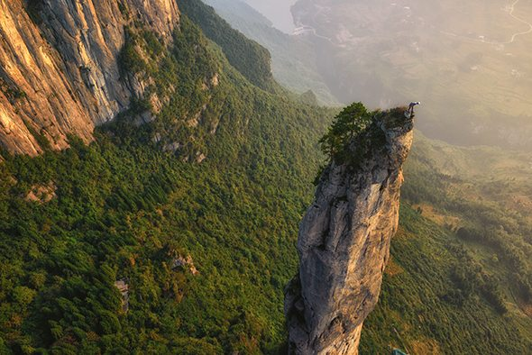 Image: On expedition with National Geographic climber standing on top of a rock spire