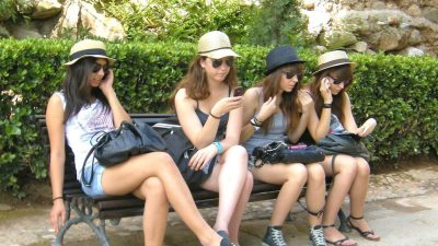 Image: 4 girls on their cellphones