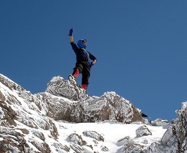 Image: Sherpa on top of Mt. Everest