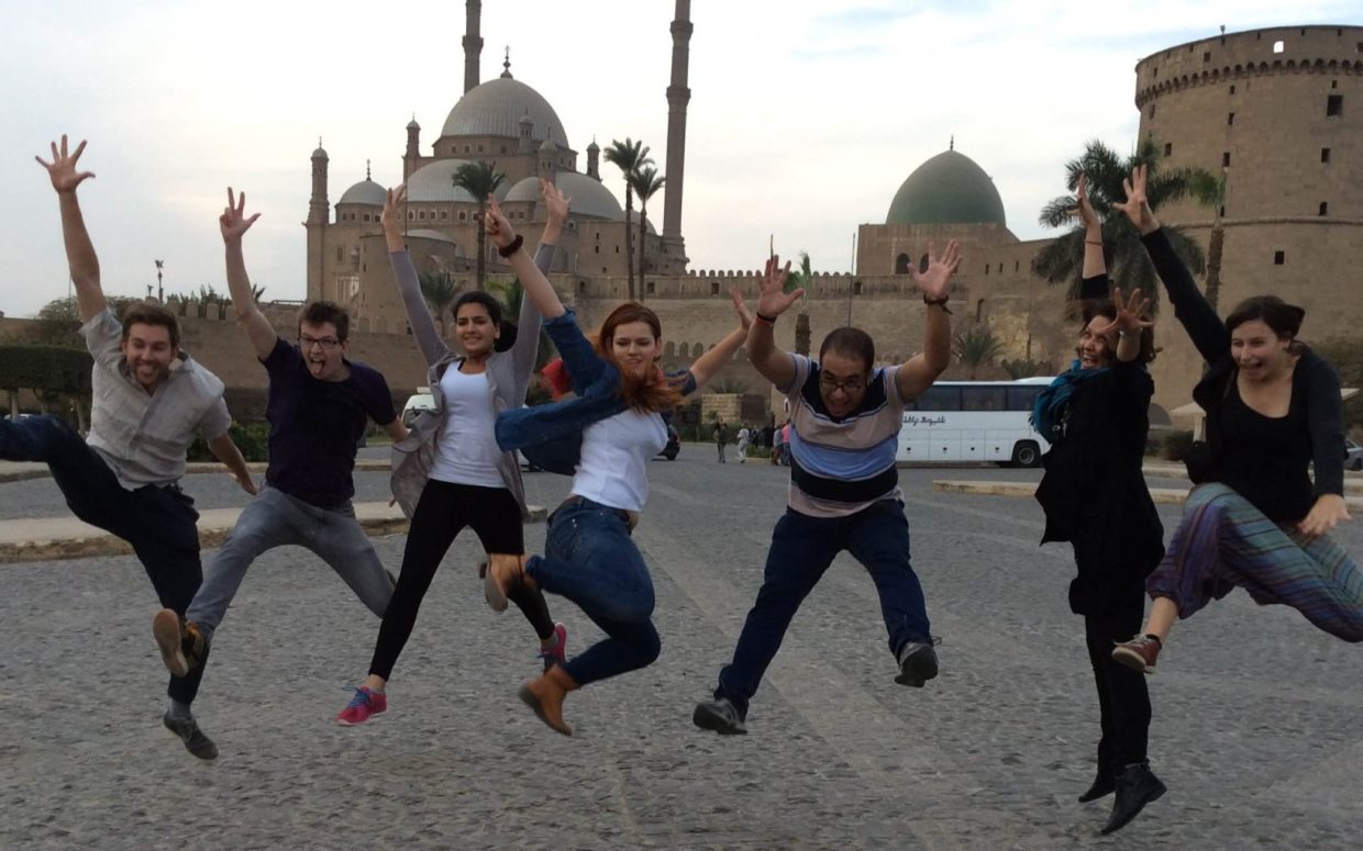 Image: Egyptian youth jumping for joy.