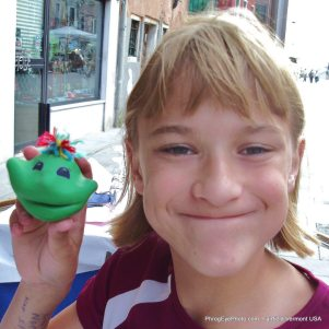 Image: Girl smiling with clay smiling face