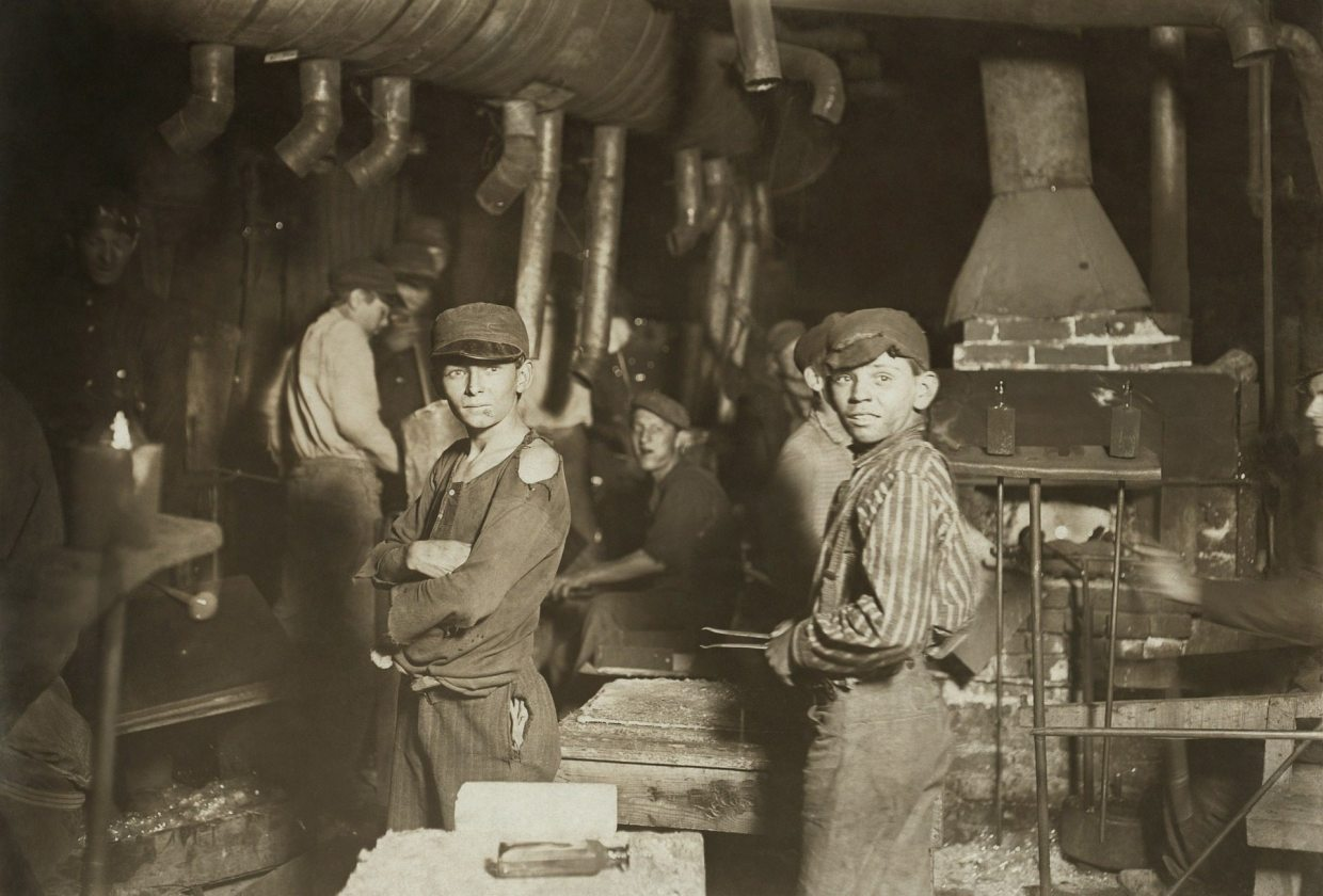 Image: Children working in a coal mine.
