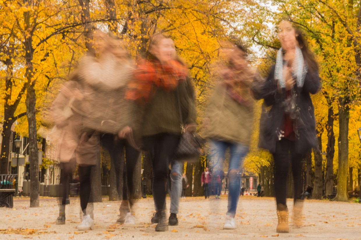Image: Blurred picture of women walking and chatting
