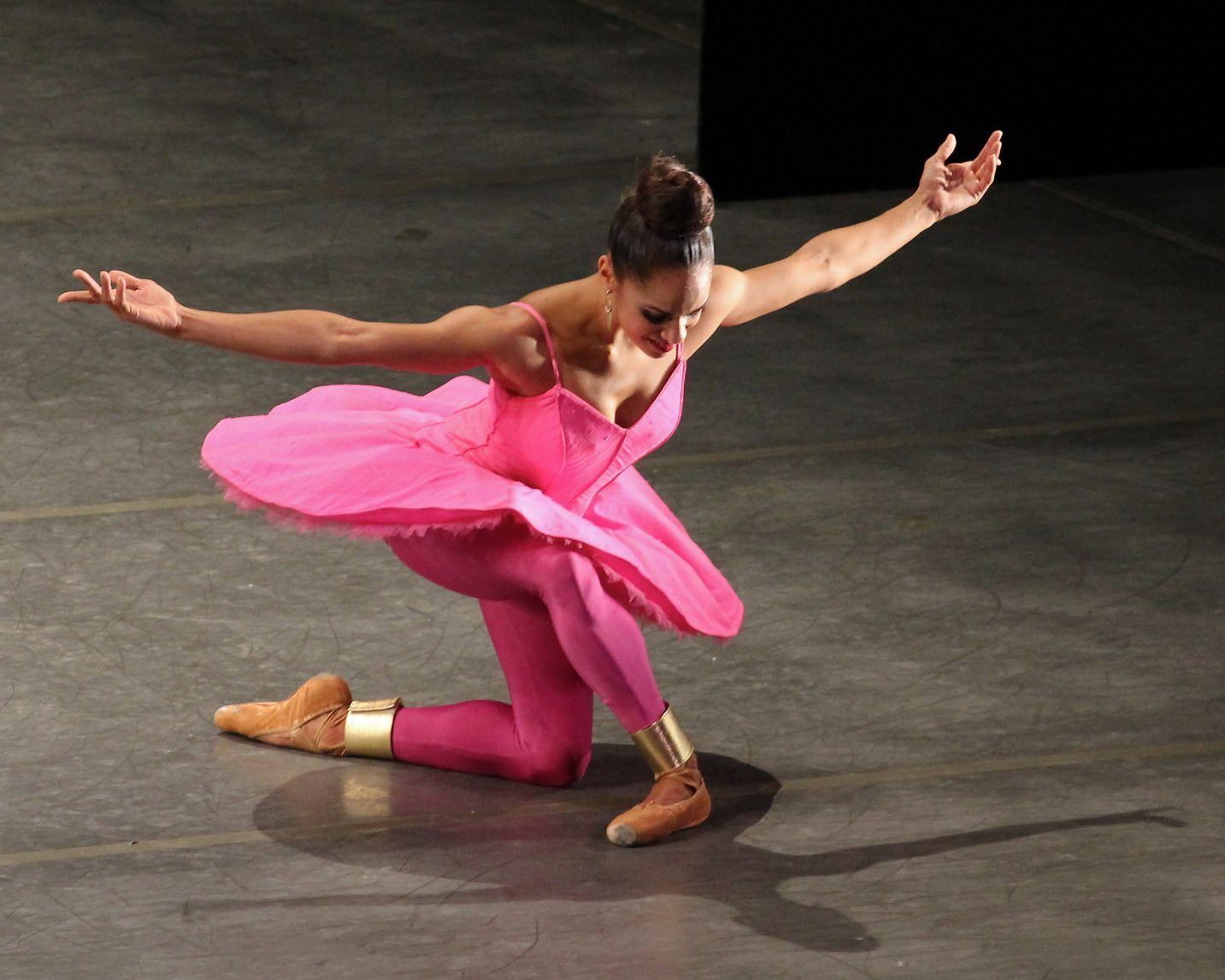 Image: Ballerina Misty Copeland in a beautiful pose in bright pink