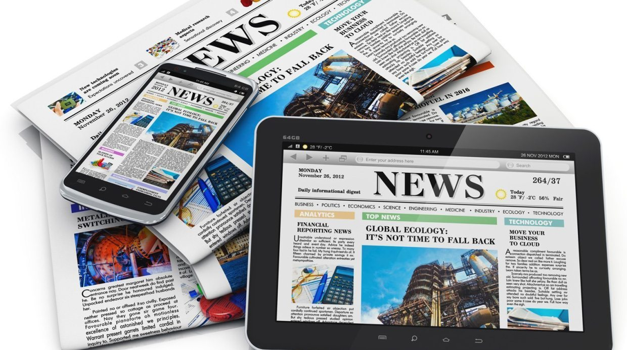 Image: Newspapers, laptops, Tables all tuned to News