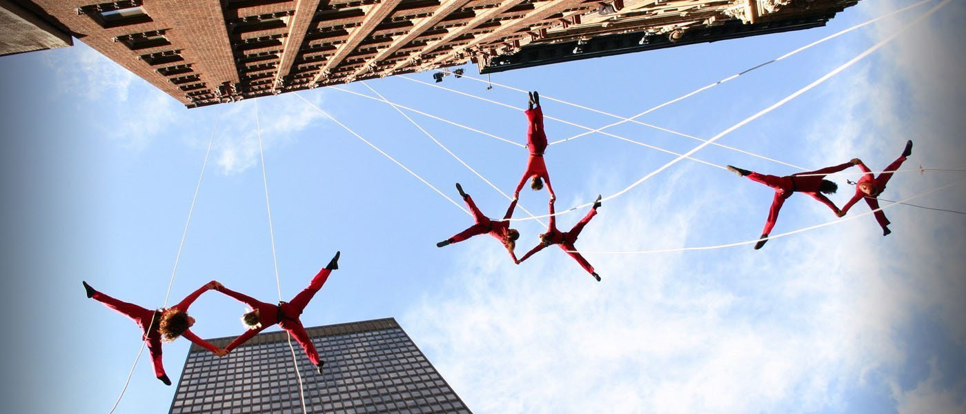 Image: BANDALOOP dancers hanging off the side of a building dancing
