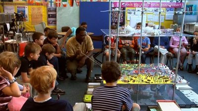 Image: Teacher John Hunter playing world peace game with students