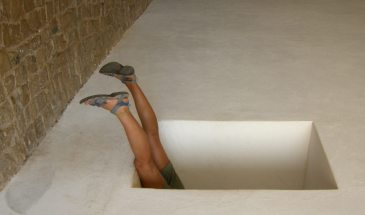 Image: Girl in a hole with legs sticking up