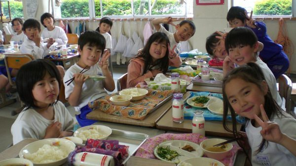 Image: Little children eating lunch very happily in Japan
