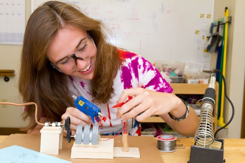 Image: Student inventing in a work space