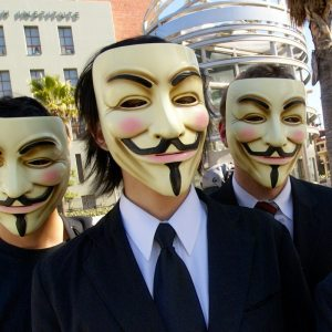 Image: Masked men with fake smiles