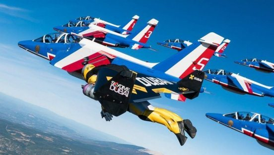 Image: Jets flying in formation with Jetman under his own wing's power