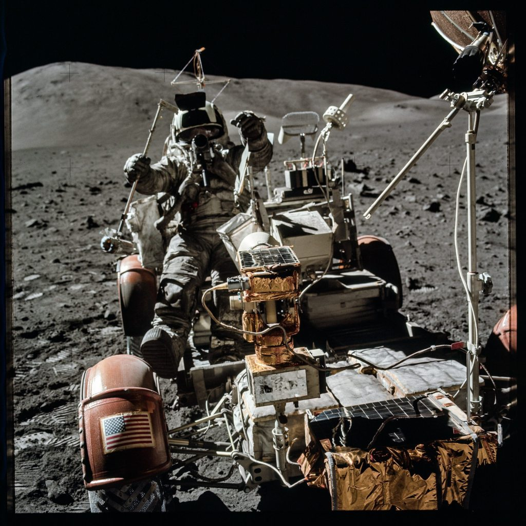 Image: Astronaut driving lunar rover--one piece of (at the time) advanced technology that made being on the moon easier.