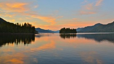 Image: Salmon colored sky over the the water on the inside passage