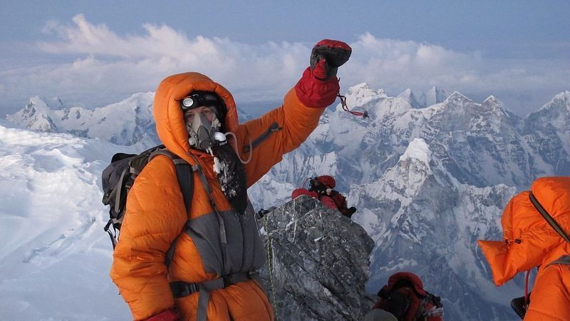 Image: Climber on top of Everest on a clear day