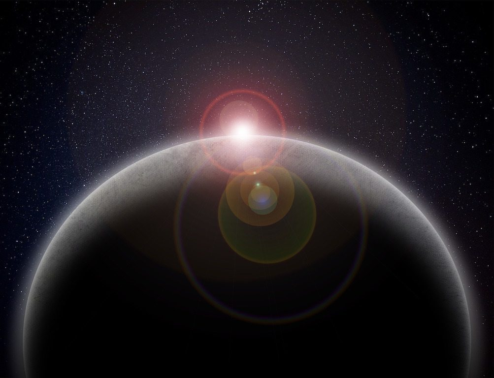 Image: artistic image of the sun rising over a planet