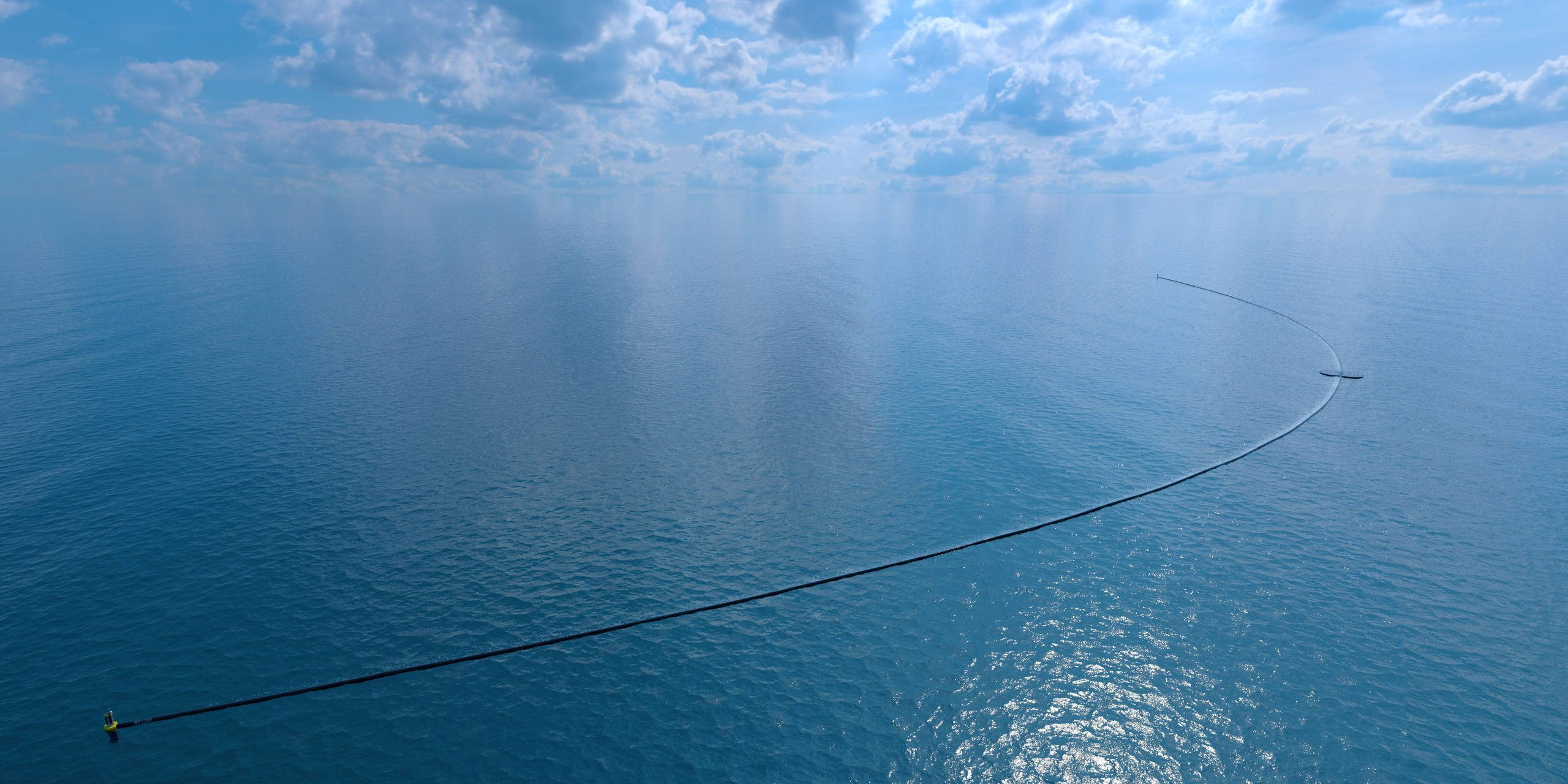 Image: Artists rendering of the Ocean Cleanup booms from the air
