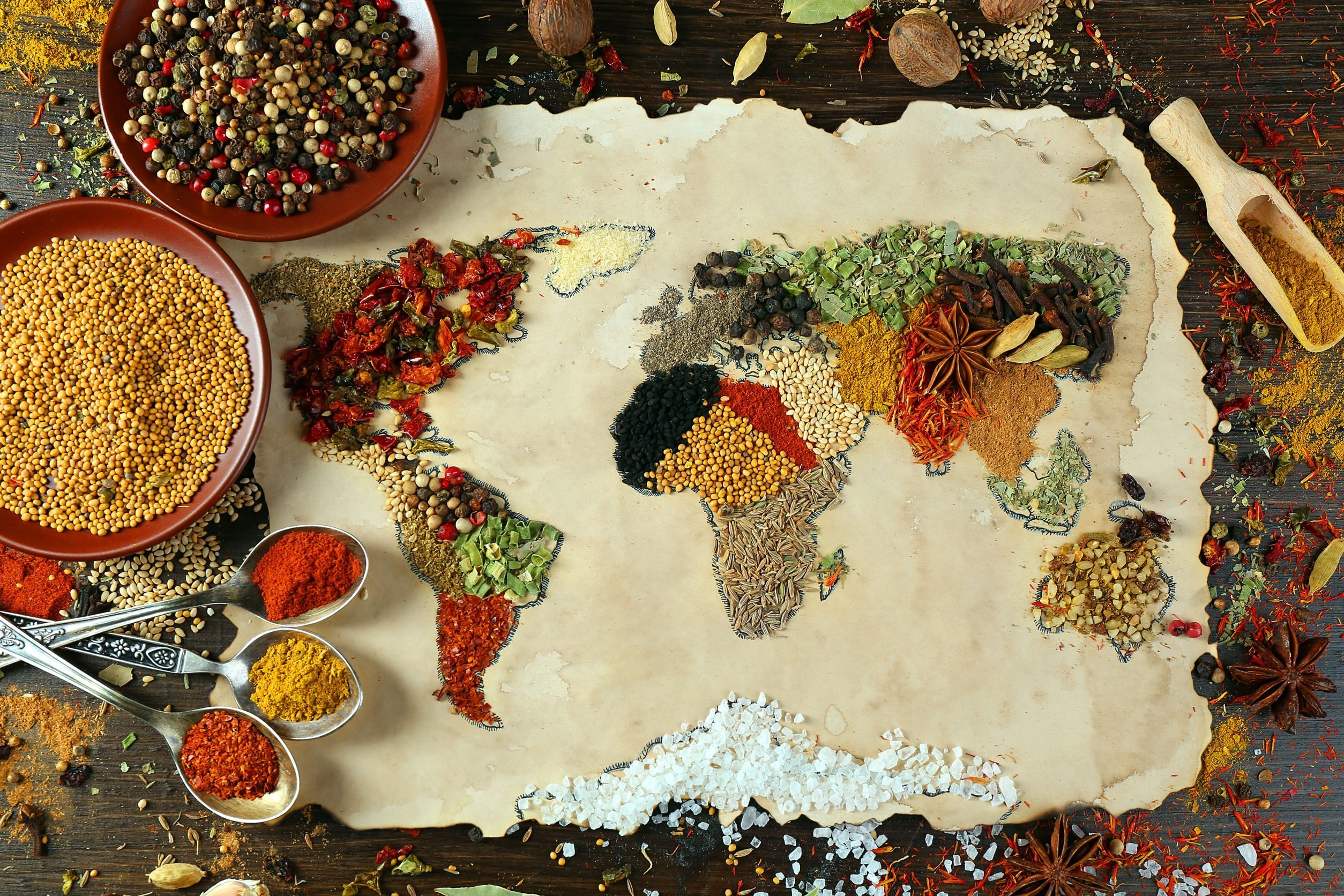 Image: map of world made from different kinds of spices on wooden background