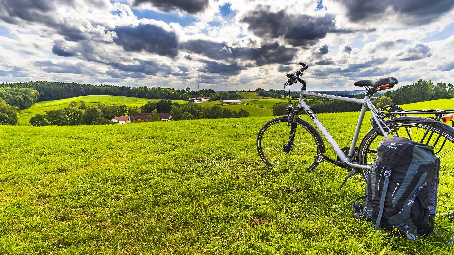 Image: A photo of a bicycle overlooking a glorious field