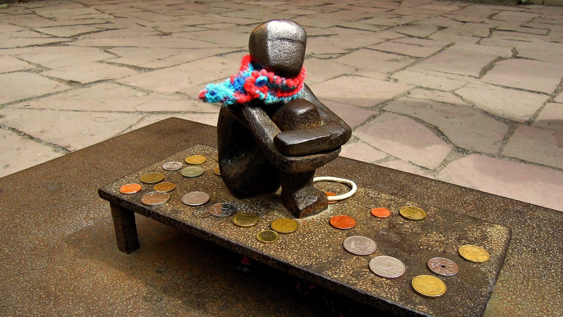 Image: Abstract sculpture of a boy sitting on a table