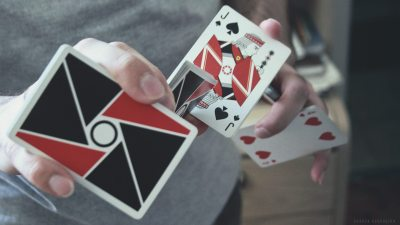 Image: A person's hand performing cardistry