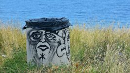 Image: Graffiti face on a garbage can