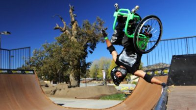 Image: Aaron Fotheringham in his wheelchair hand planting on rail.