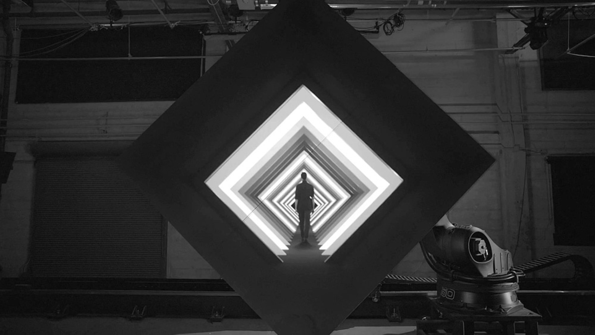 Image: Screen Capture from Box by Bot and Dolly of person walking into geometric shapes showing new innovations in projection technology