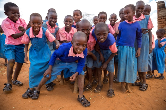 Image: Group of school children wearing the shoe that grows