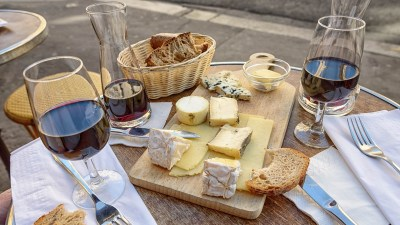Image: Wine and cheese on a table