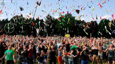 Image: People celebrating wildly throwing colorful things in the air