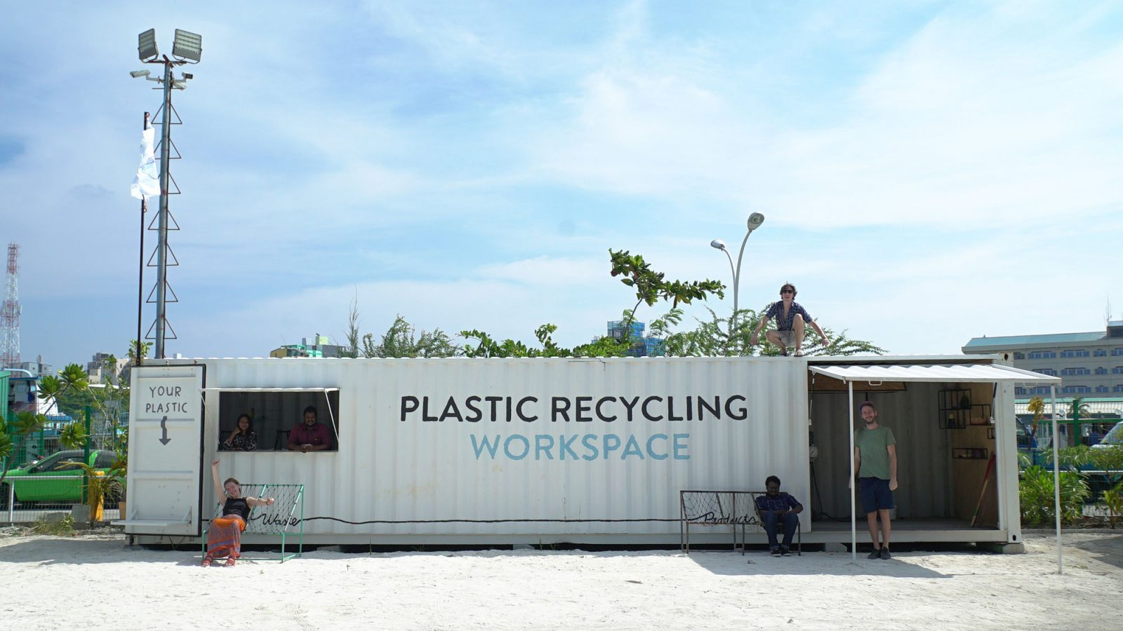 Image: Precious Plastic team members with the plastic recycling workspace in the Maldives