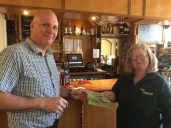 Handing over copies of the Every Barn... project postcard at Kearton Tea Rooms
