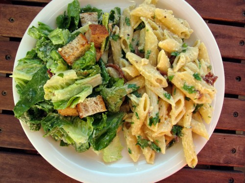 penne carbonara with caesar salad on the side