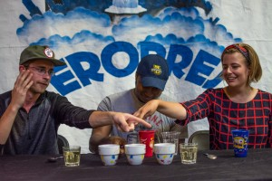 The judges point their vote at which cup tasted best.