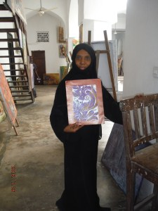 Majda shows her painting, saying Asante for the opportunity it brings.