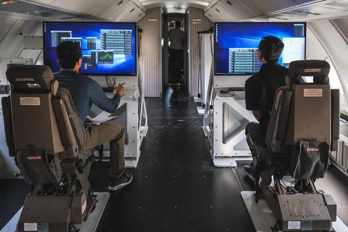 screens computers people engineers 747-400 boeing virgin robit rocket plane cockpit chair black white data graphs math physics