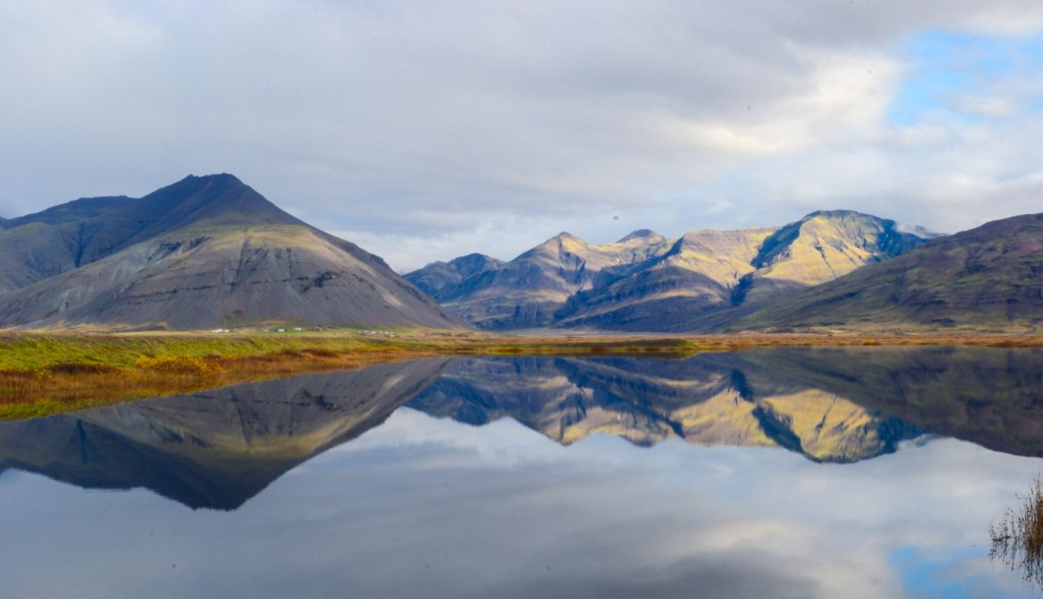 reflections of mountains on a lake, Iceland