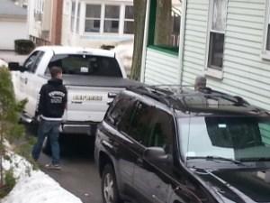 neuro car pulling into neighbor's driveway