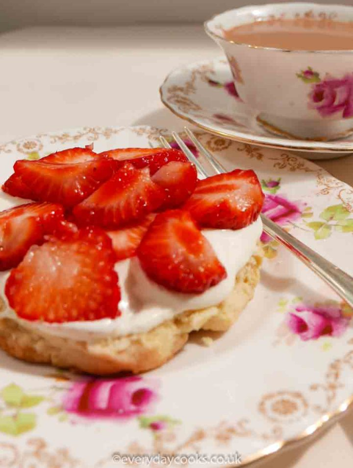 Strawberry shortcakes with whipped cream and a cup of tea.