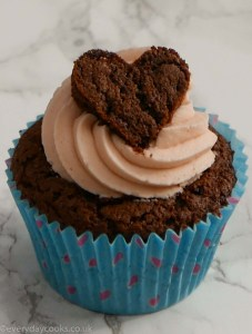 Chocolate Valentine cupcake with pink buttercream and a chocolate heart