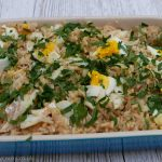 Kedgeree garnished with parsley in a gratin dish