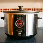 A brushed steel digital slow cooker