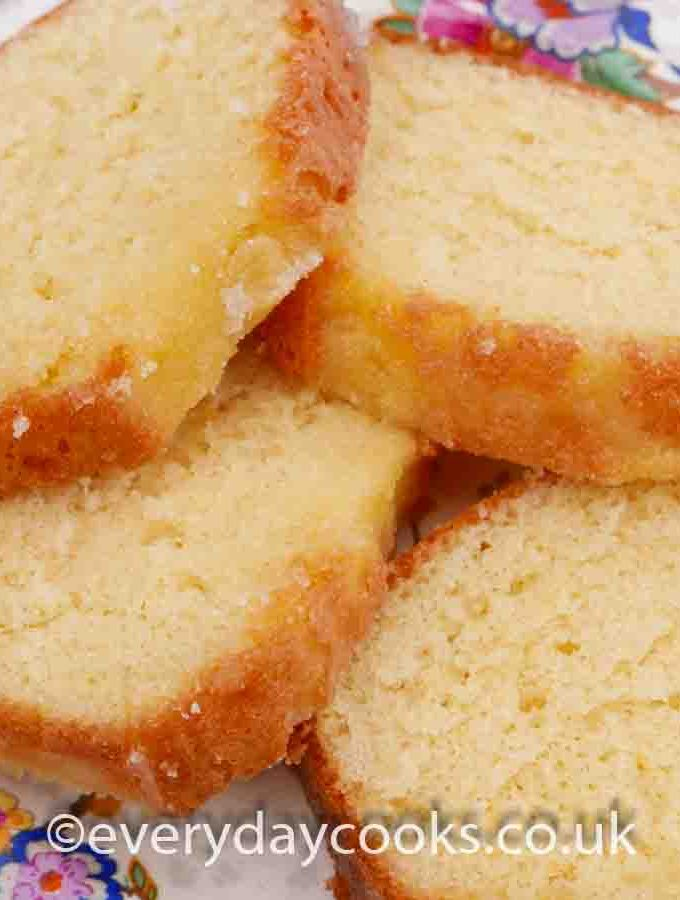 Slices of Crunchy Lemon Drizzle Loaf on a patterned plate
