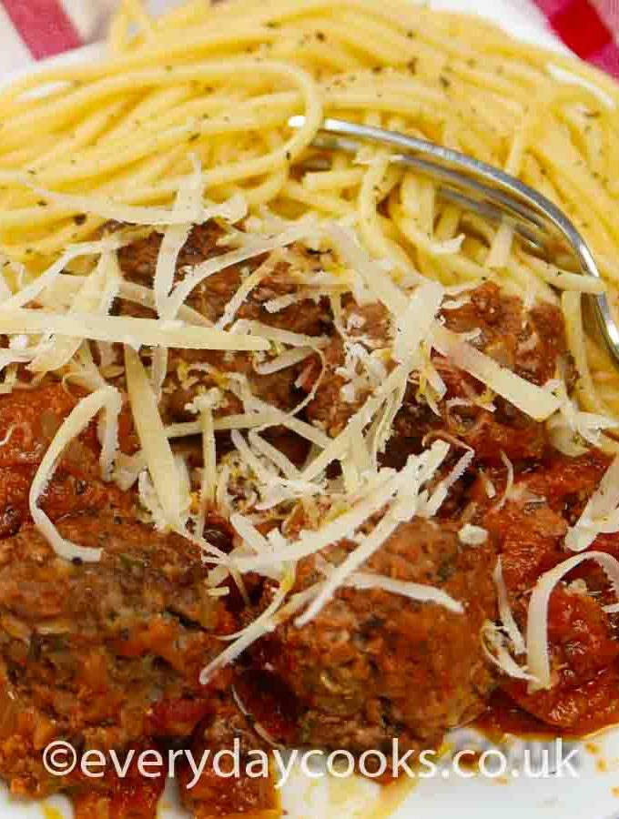 Meatballs n Tomato Sauce with spaghetti on a white plate