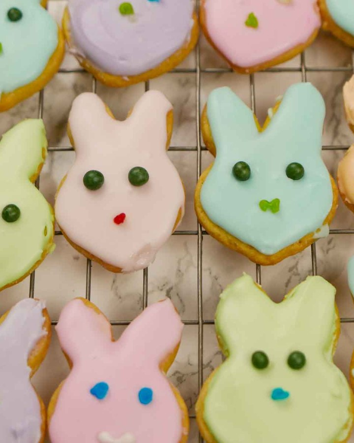 Iced Easter Bunny Biscuits and chicks in a variety of colours on a wire rack