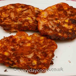 3 Sweetcorn Fritters on a white plate