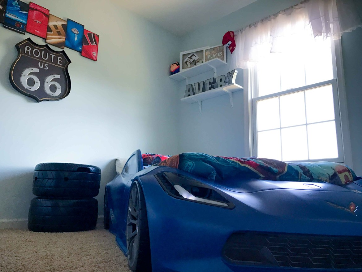 Blue race car themed room for a toddler boy