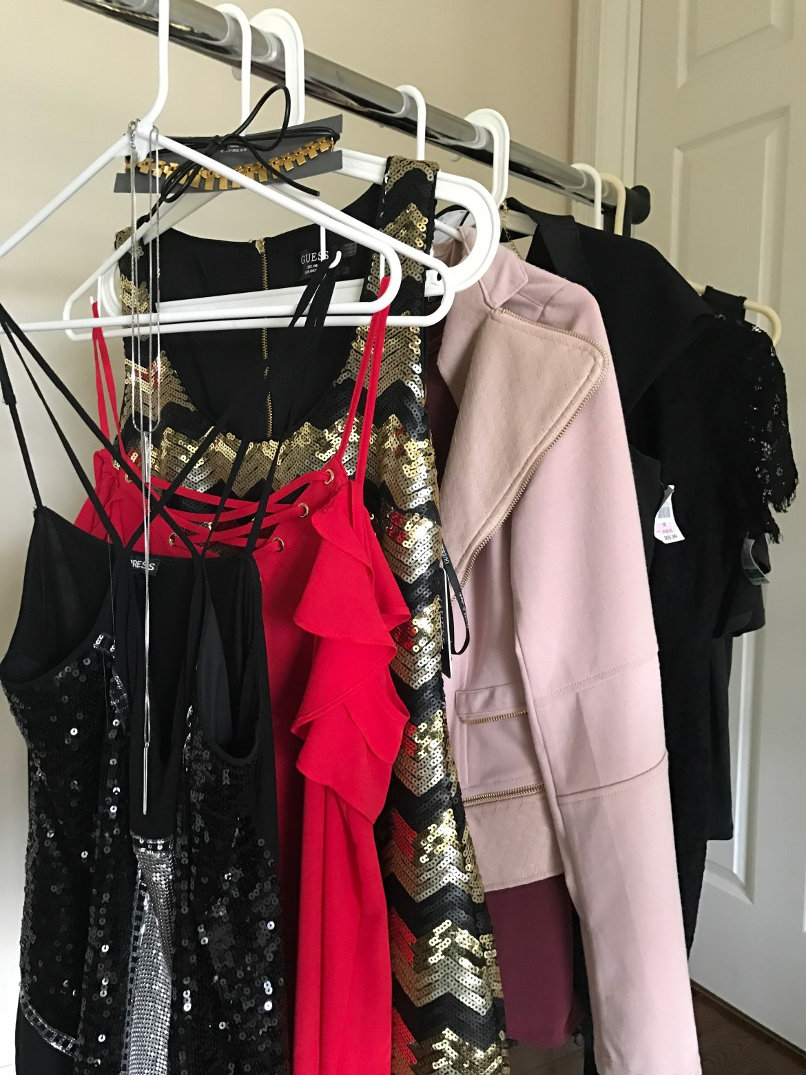 outfits hanging up that are perfect for Vegas fashion