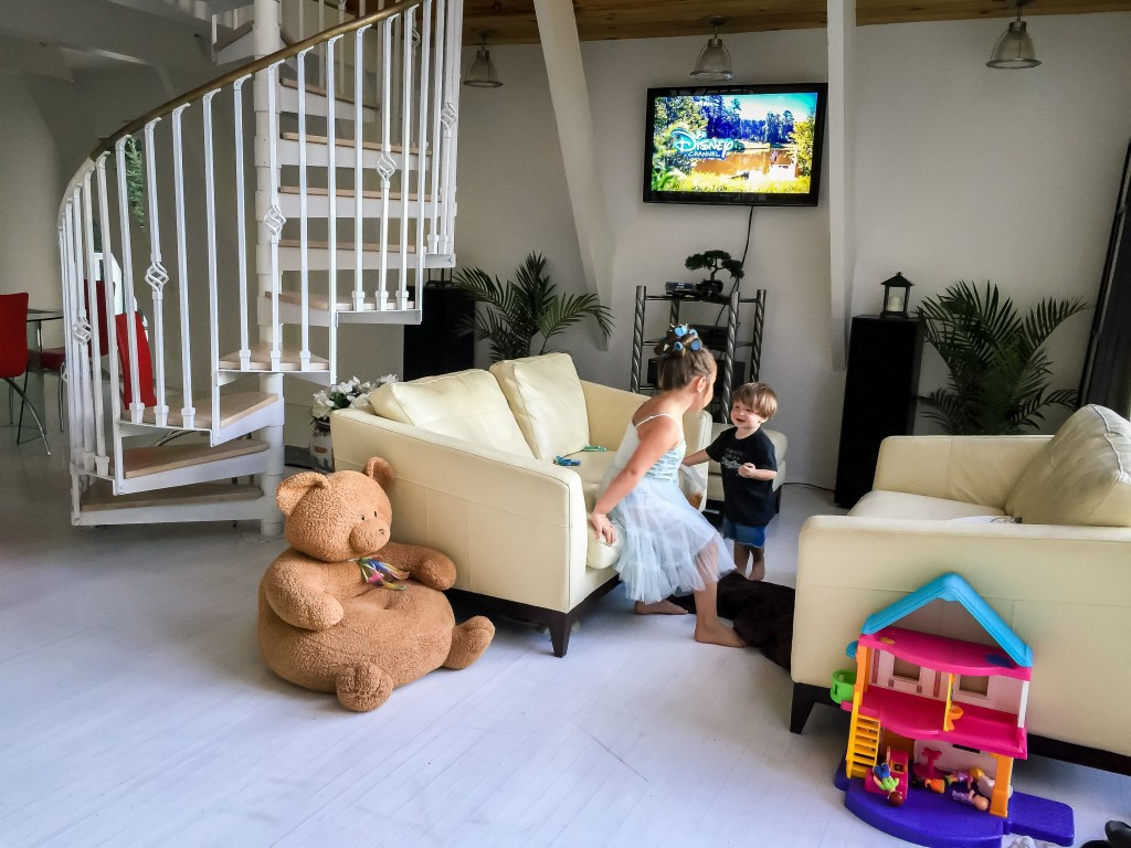 2 kids playing in an Airbnb living room